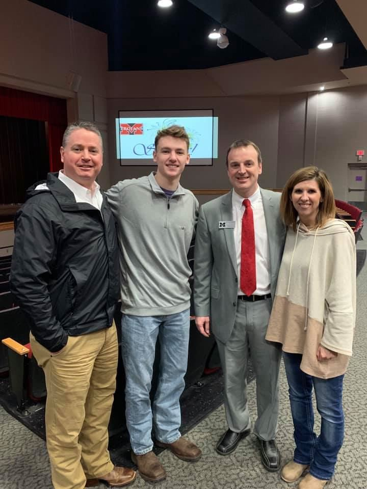 Clay pictured with parents, Ron & Cassie Tyler, along with Principal Chad Holden